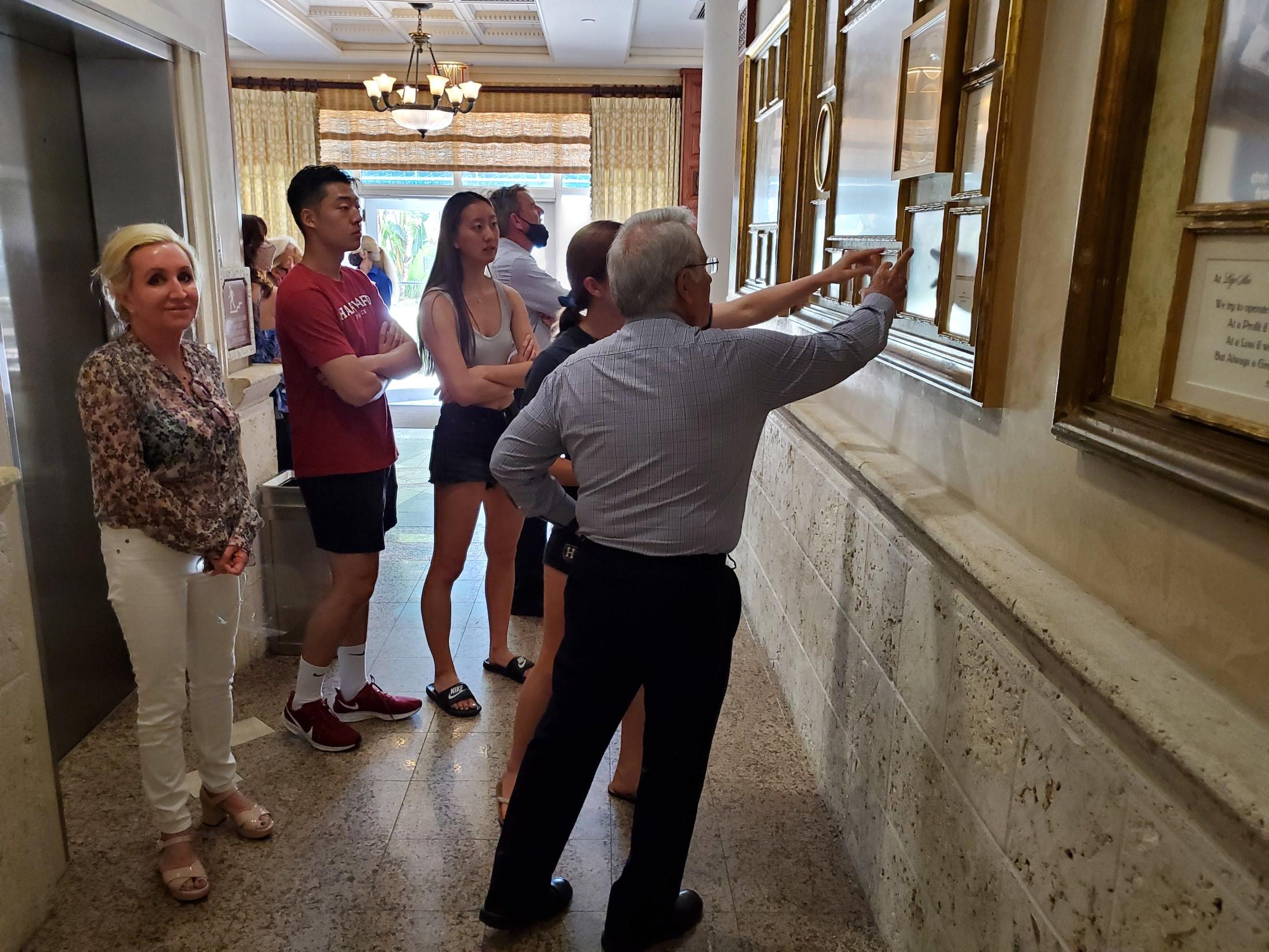 Walter Banks Lago Mar CEO checking out historic wall 60th anniversary