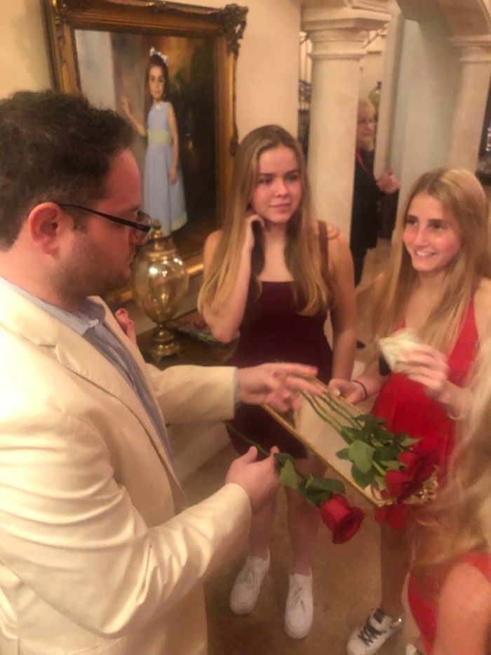 dani snyder passing out roses at bachelor viewing party and fundraiser