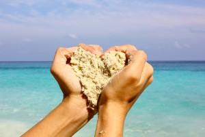 hand heart sand beach